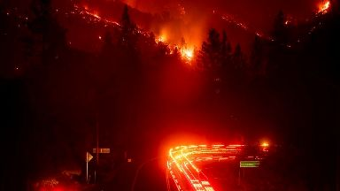 Trucks abandoned as wildfire scorches California freeway