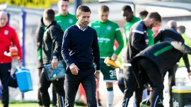 Frustrated: Neil McCann walks off at full-time after Dundee's loss to Hibs.
