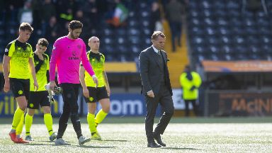 Challenge: Brendan Rodgers leads his Celtic players off the park after suffering defeat at Kilmarnock.