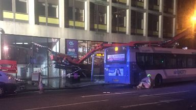 Collision: Between cherry-picker and bus.