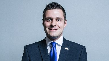 Official portrait of Ross Thomson