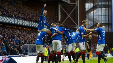 Rout: Rangers players celebrate one of seven goals.