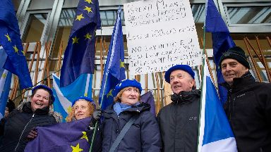Pro-European protestors outside the Scottish Parliament, Edinburgh, as a vote is held against Theresa May's proposed Brexit deal with MSPs calling instead for a 'better alternative' to the PM's plans to be taken forward.