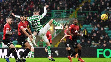 Strike: Mikael Lustig steers home Celtic's third goal.