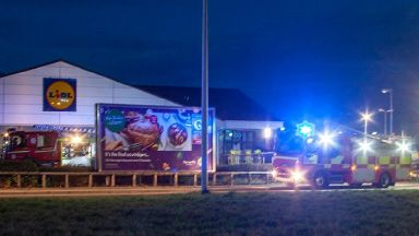 Lidl: Around 20 firefighters are tackling the flames. (Picture by Marc Hindley/Forres Web)