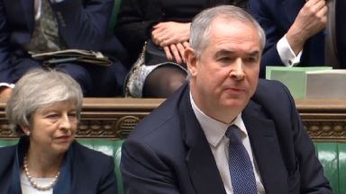 Prime Minister Theresa May listens to the Attorney-General Geoffrey Cox, speak in the House of Commons ahead of the Commons vote on the Prime Minister's Brexit deal.