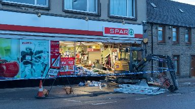 Spar: The shopfront has been destroyed.