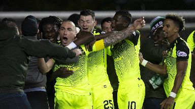 Winner: Brown celebrates with the Celtic support.