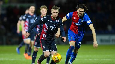 Derby: Ross County's Billy McKay and Inverness' Charlie Telford vie for possession.