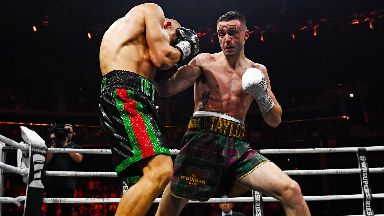 Josh Taylor in action with Ivan Baranchyk