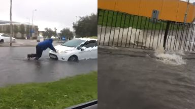 Floods: Cars were stuck in the water in Aberdeen. (Pics by Fubar News)