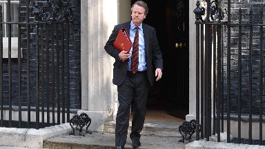 Scotland Secretary Alister Jack leaves 10 Downing Street following the first cabinet meeting with new Prime minister Boris Johnson on July 25, 2019