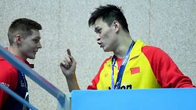 Sun Yang (R) of China speaks with Duncan Scott