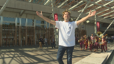 Andrew Maxwell as Julius Caesar marching on the Scottish Parliament Edinburgh Fringe 2019.
