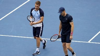 Neal Skupski (R) and Jamie Murray of Great Britain in action during their Men's Doubles semi-final match 2019