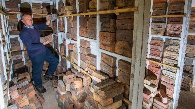 Mark Cranston and collection of bricks