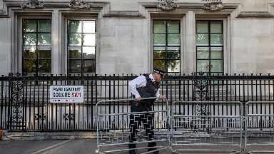 A police officer lays out barriers ahead of the opening of a Supreme Court hearing on the legality of proroguing Parliament, on September 18, 2019