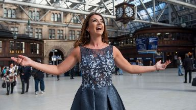 Monica McGhee performs at Glasgow Central Station for Stand Up To Cancer October 1