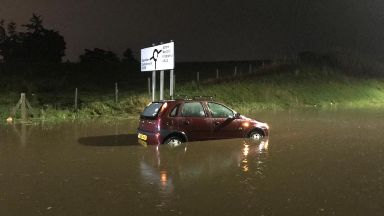Flooding: An abandoned car following heavy rain.