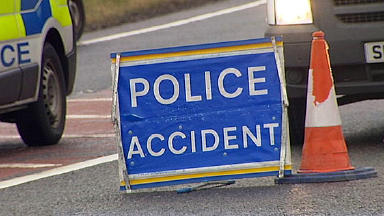 Accident: The road is closed as police carry out investigation.