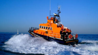 Lifeboat crewman airlifted to safety