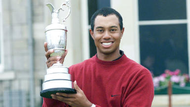 Number one: Tiger Woods poses after winning the Open in 2000.
