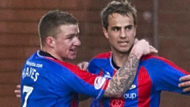 Andrew Shinnie (right) celebrates with Johnny Hayes