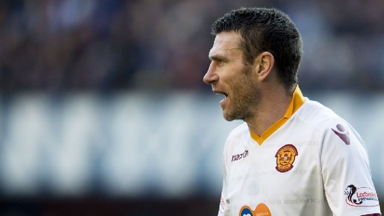 Motherwell defender Stephen McManus hangs up his boots