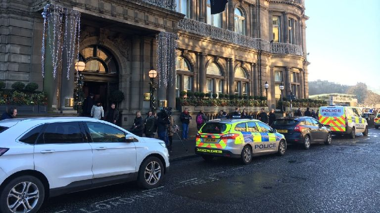 Princes Street shut after man hit by debris from B