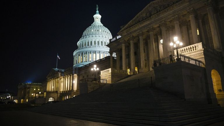 US government shuts down again as budget vote bloc