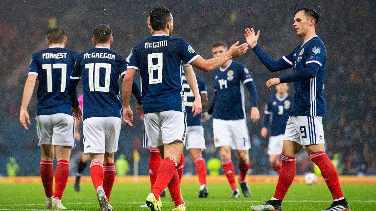 Scotland hit San Marino for six at rain-soaked Hampden